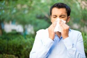 Fall Allergies Man Blowign nose into tissue