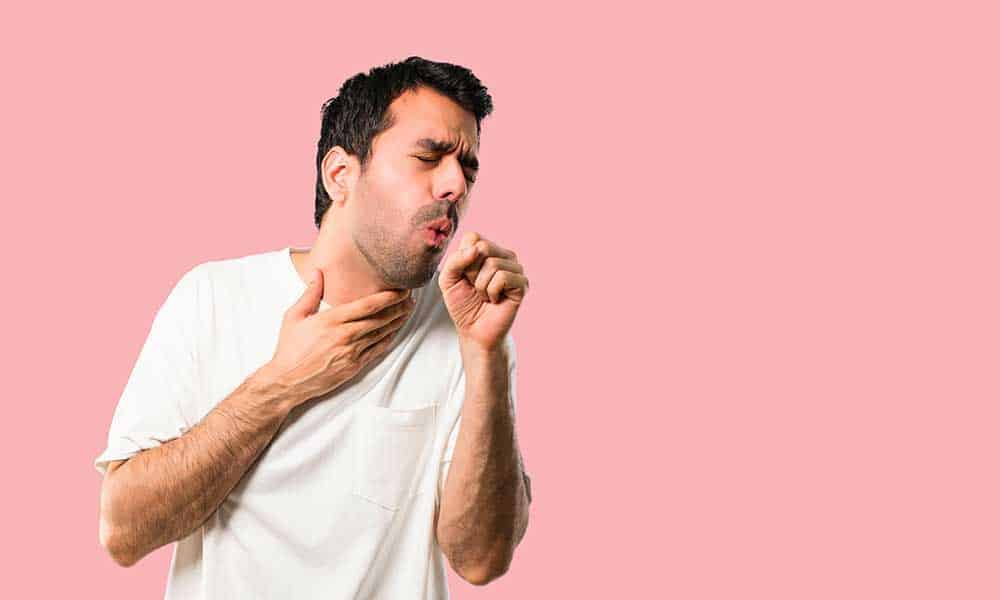man coughing from cigarettes
